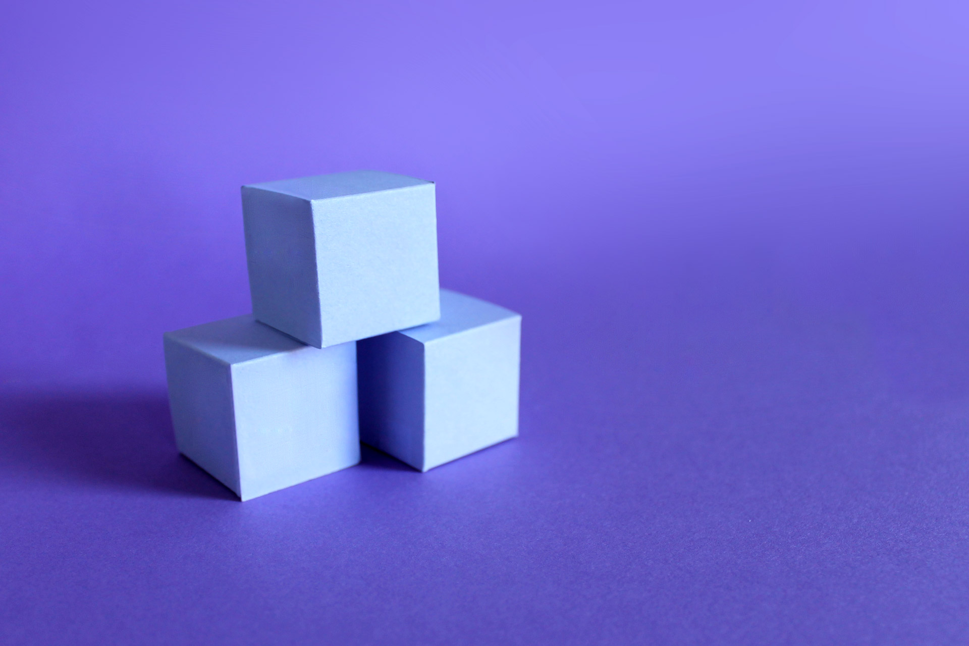 Three stacked purple building blocks