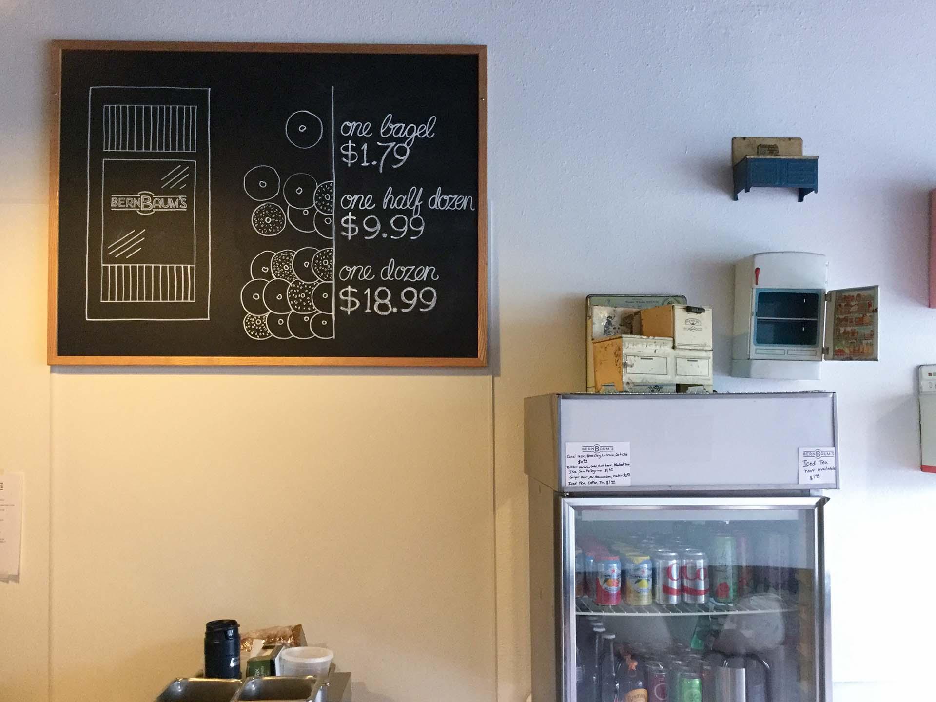 Pricing chalkboard on display in BernBaum's near refrigerator