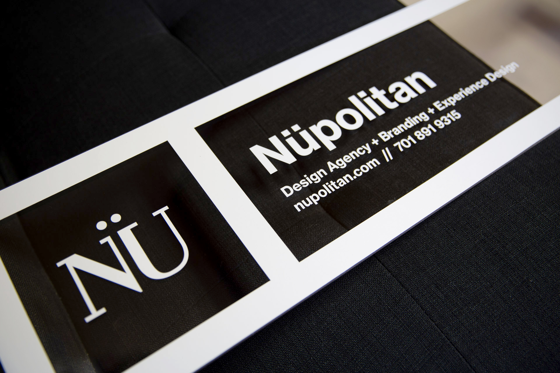 Rectangular acrylic panel with white vinyl for Nüpolitan's window sign