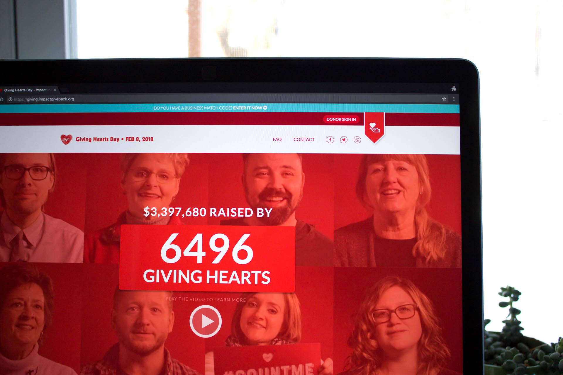 Close-up of laptop screen displaying live counter of donors on Giving Hearts Day