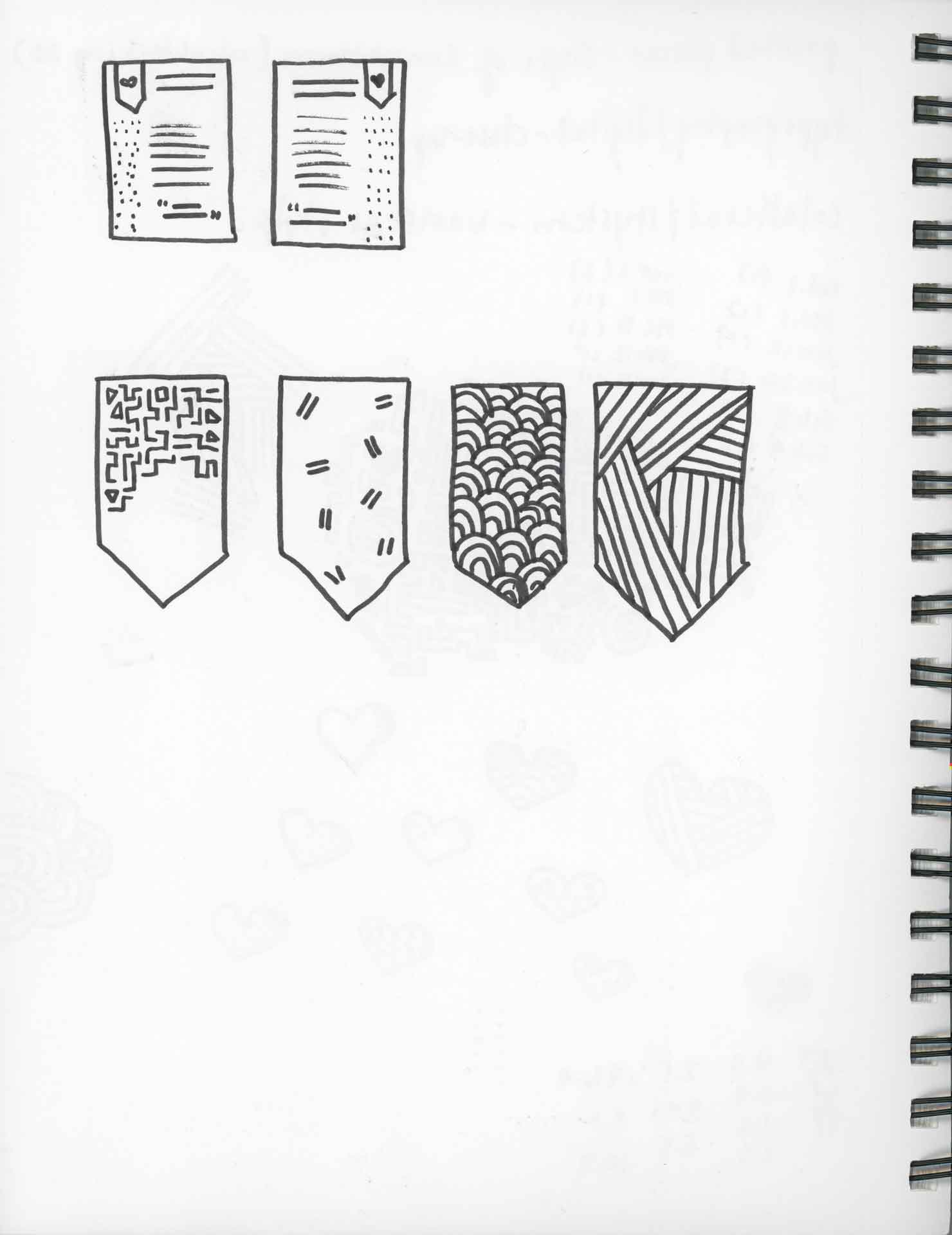 Single page of sketch book with sketches of patterned banners