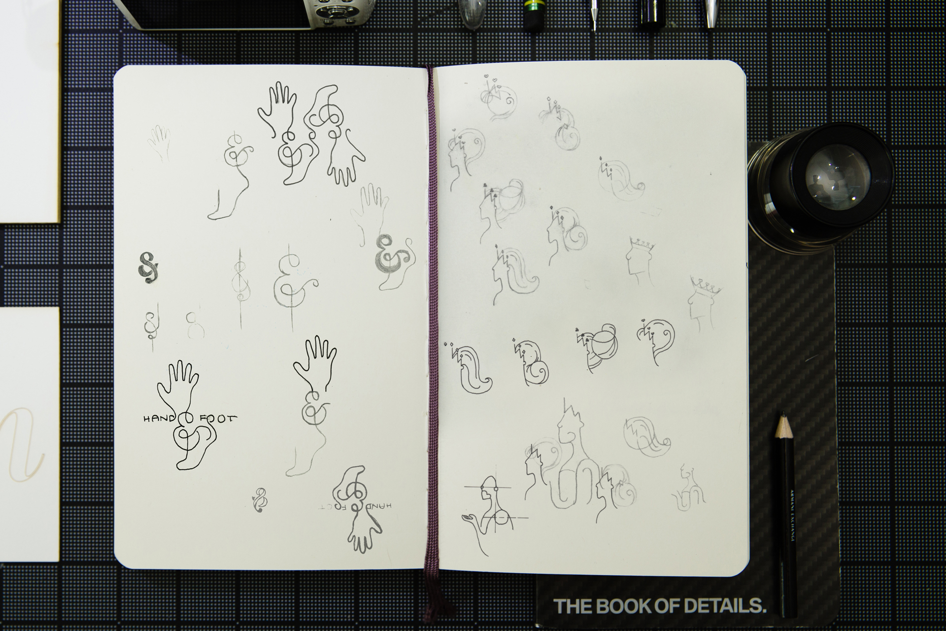 Sketchbook featuring logo concept sketches