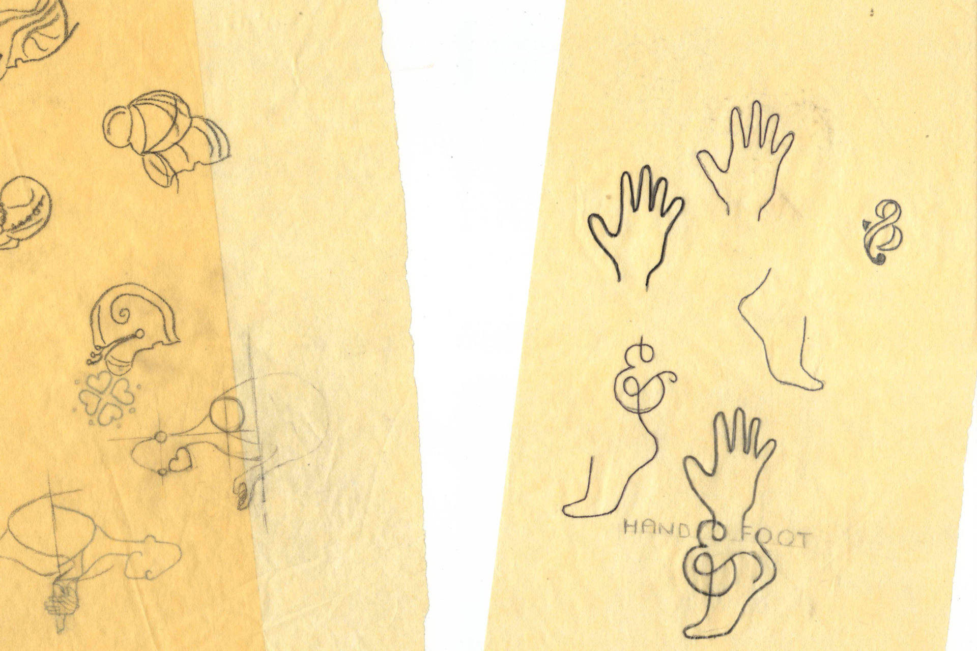 Yellow tracing paper with sketches of hands and feet on them