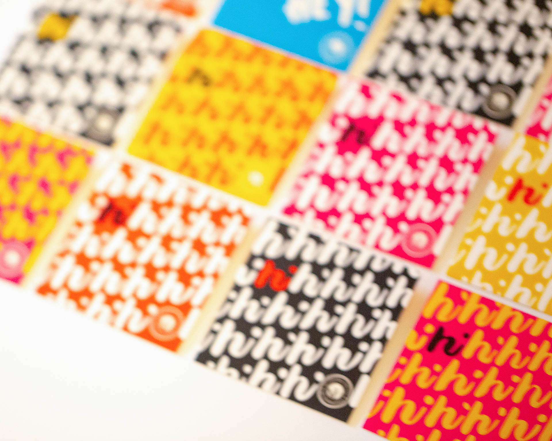 A grid of colorful square cards on a white background