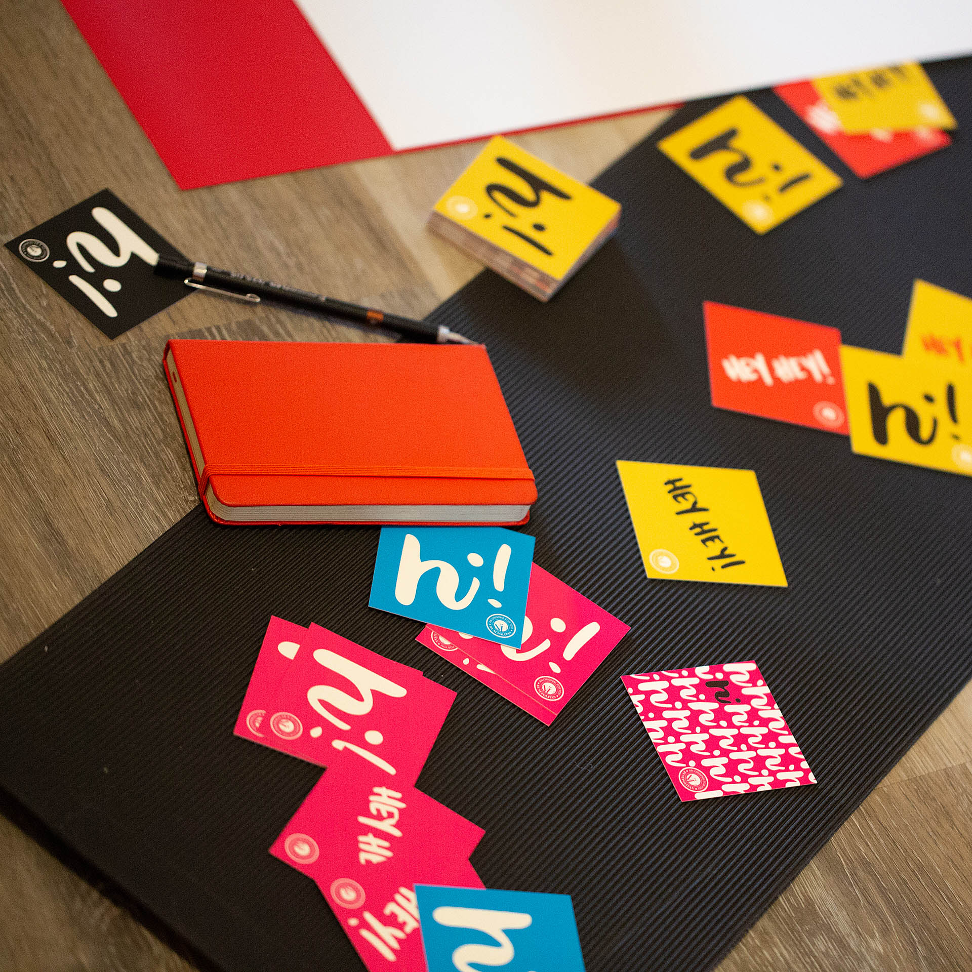 Colorful square cards scattered on a piece of black paper