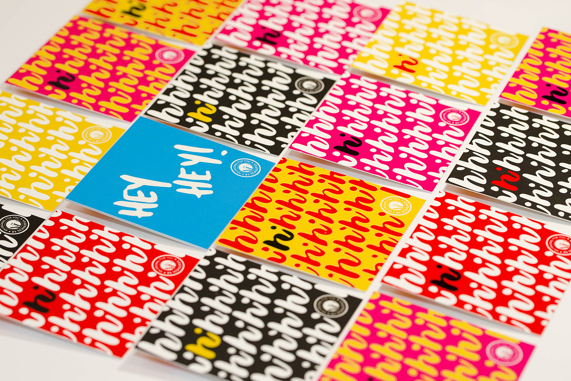 An isometric grid of 16 square, colorful cards on a white background