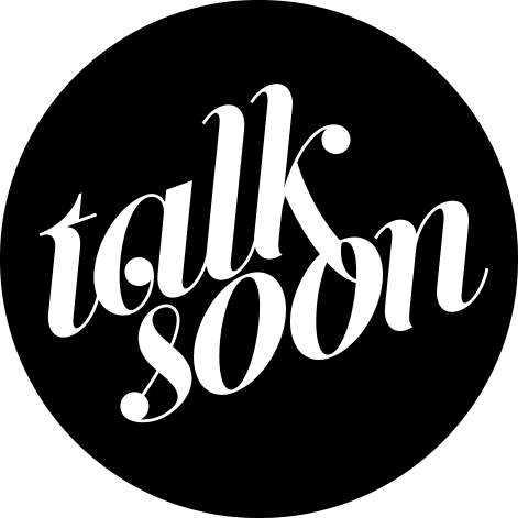 Black circle with the words talk soon in a decorative font punched out in the center