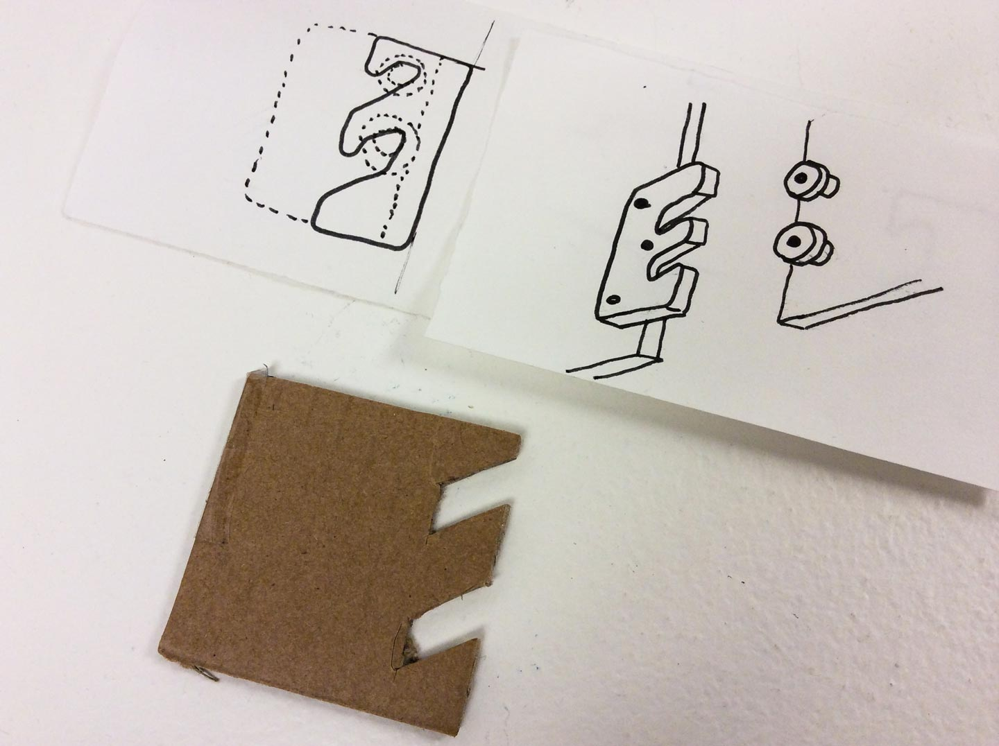 Sketch and prototype of small wooden bracket