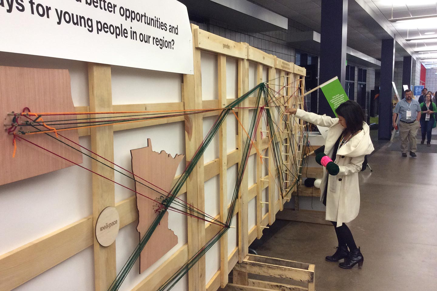 Woman interacting with wood and yard installation