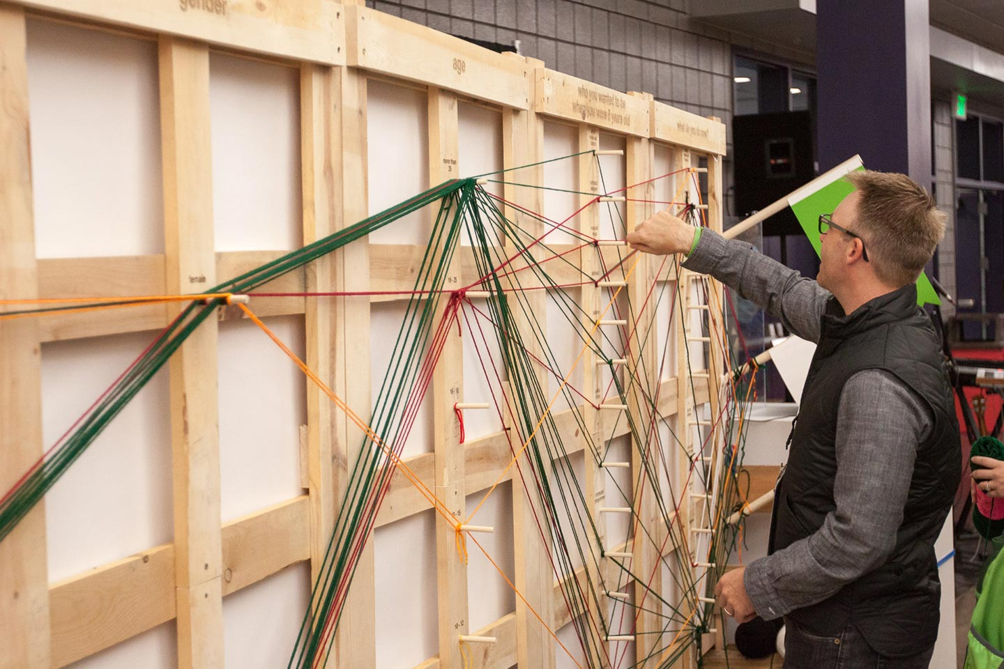 Man interacting with wood and yard installation