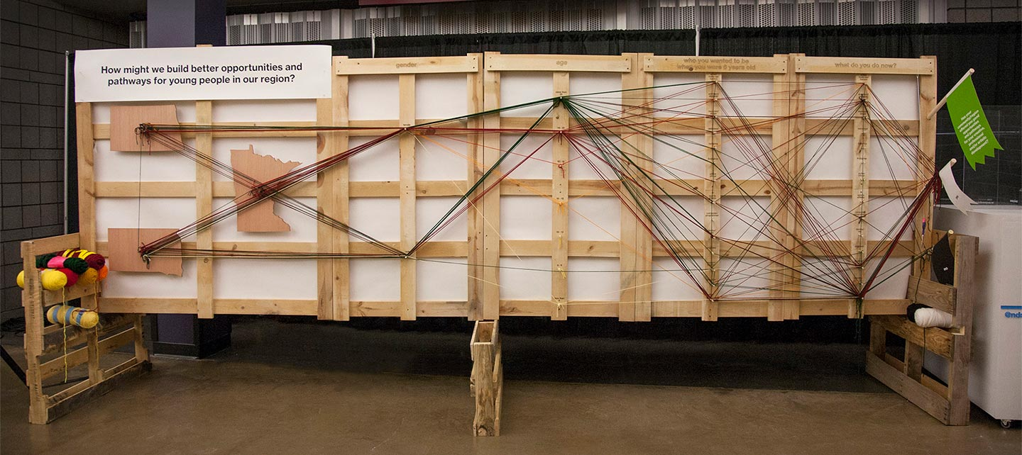 Large installation made from wood and yarn