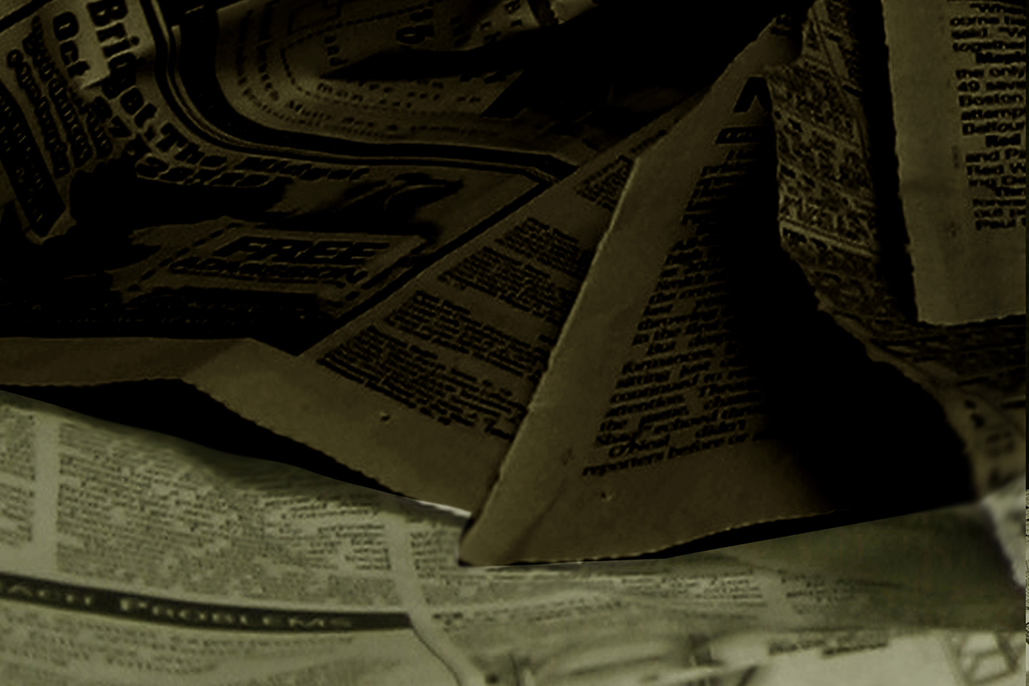 Photo of dark sheets of newspaper