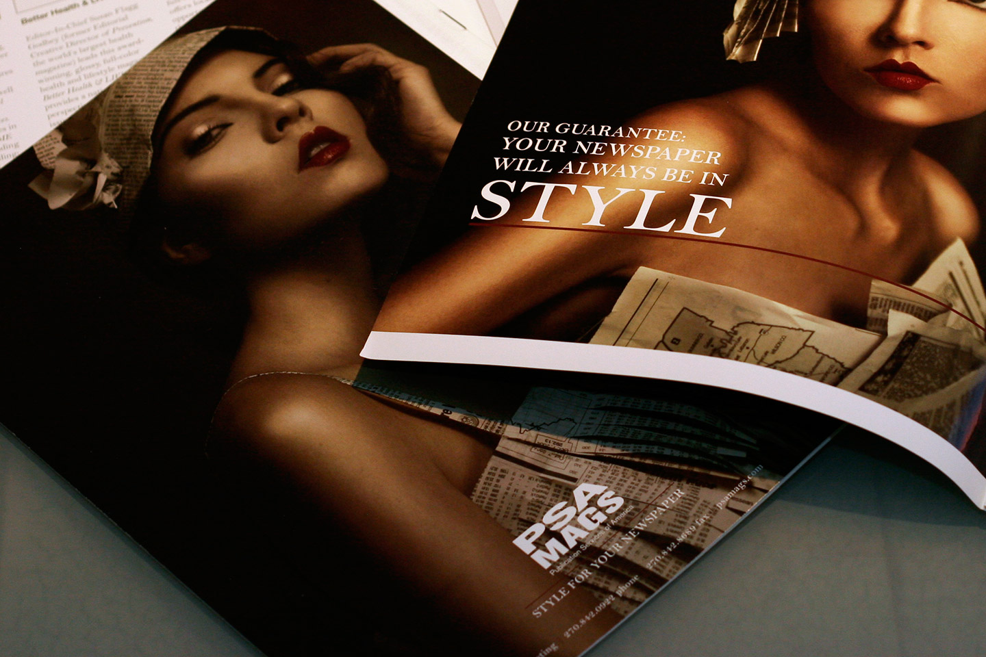 The corner of a magazine featuring the word Style on top of another magazine featuring a photo of a woman's shoulder