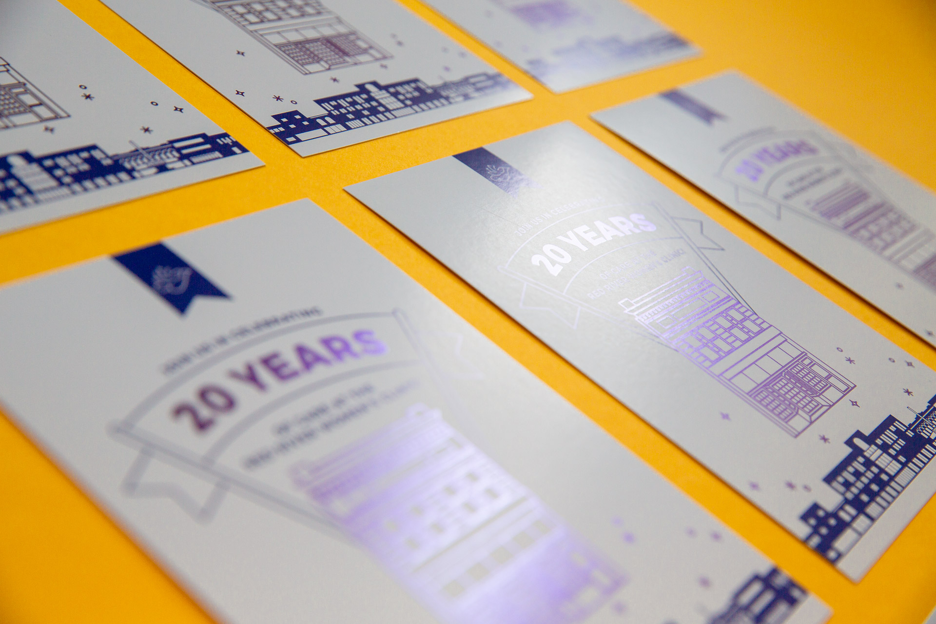 Grid of white postcards with purple illustration and lettering on a yellow background