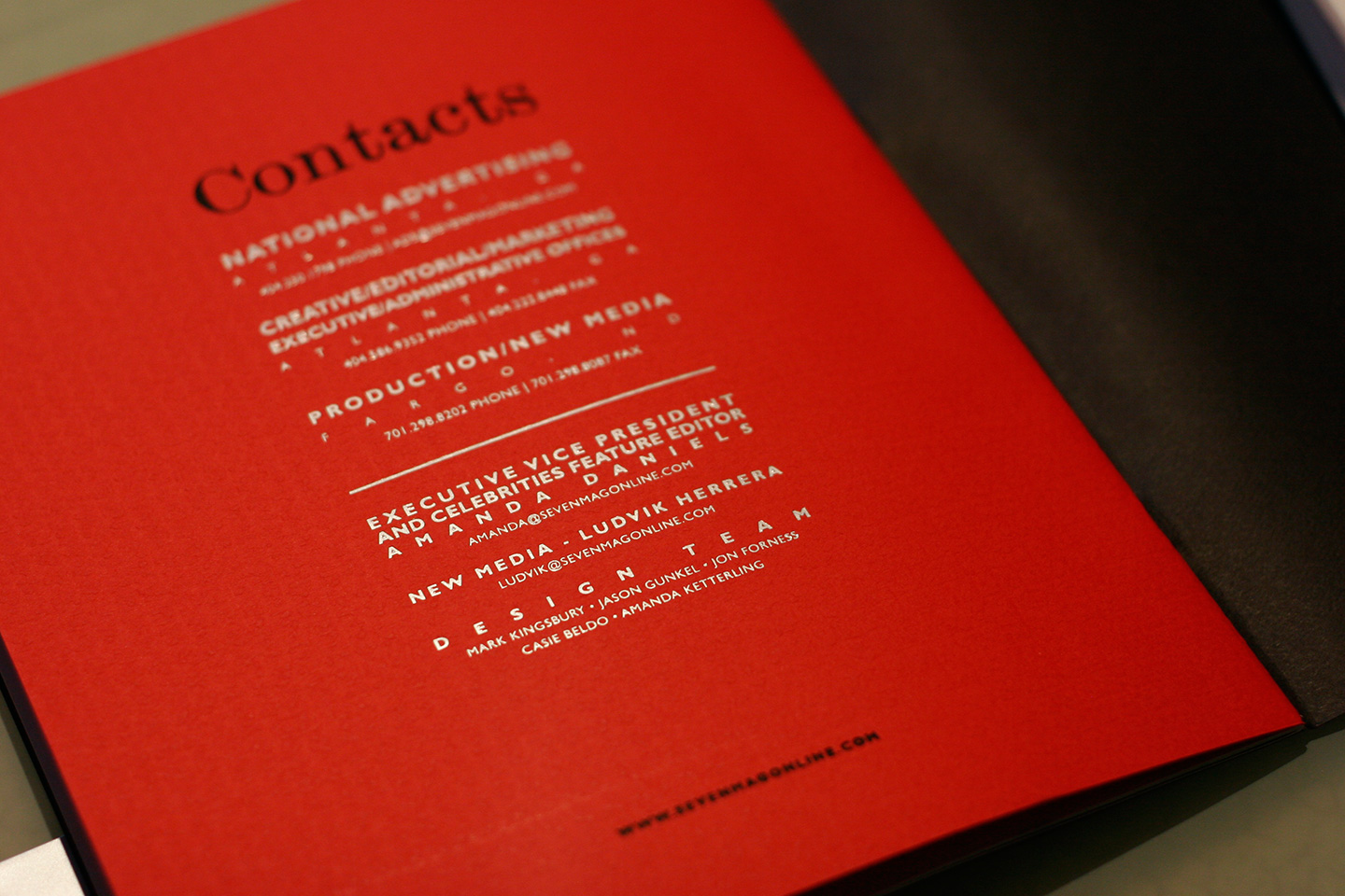 Red page of a magazine with black and white text