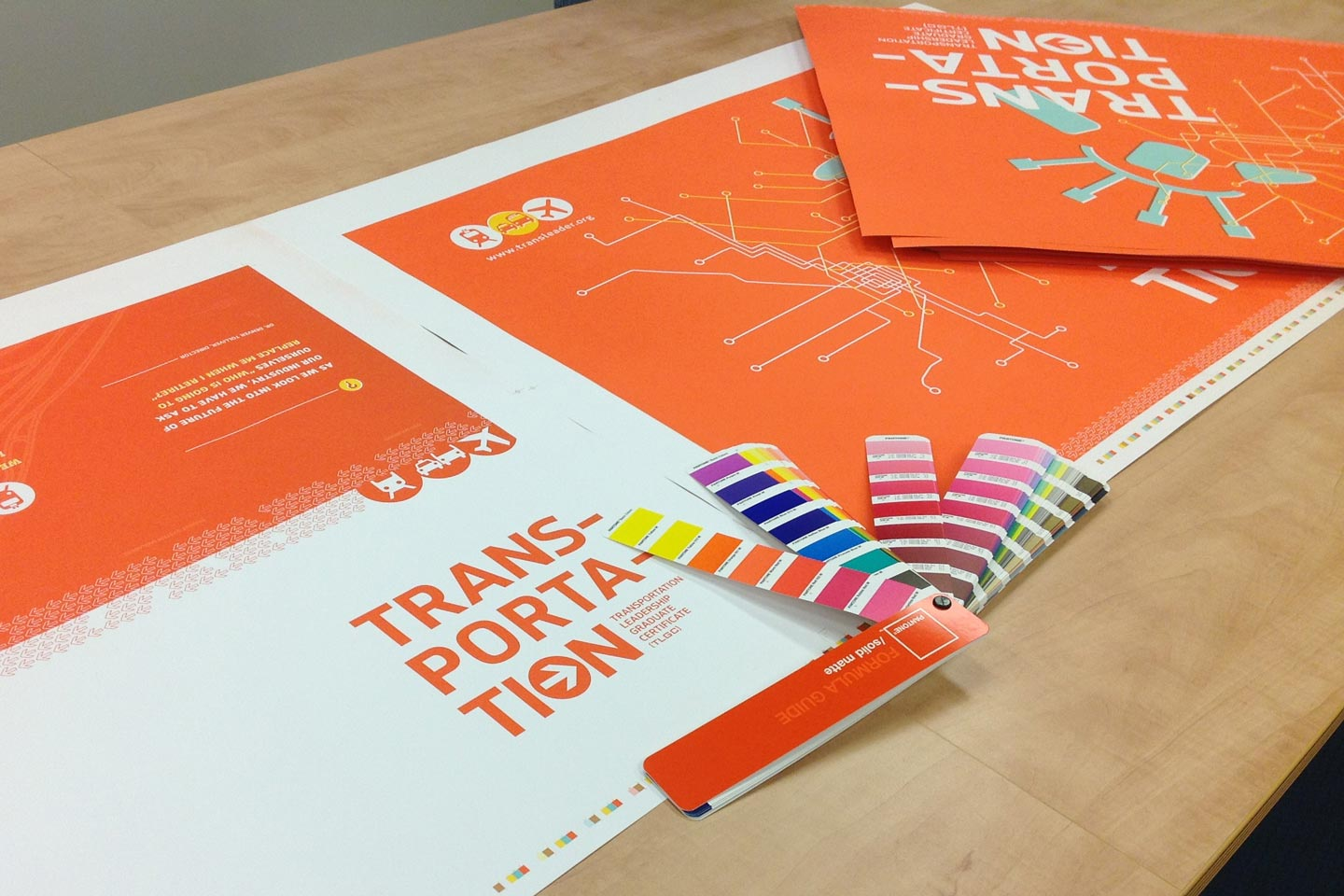 Color swatches and printing proofs of transportation brochure and poster
