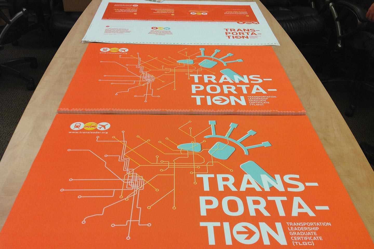Orange, green, and white transportation posters