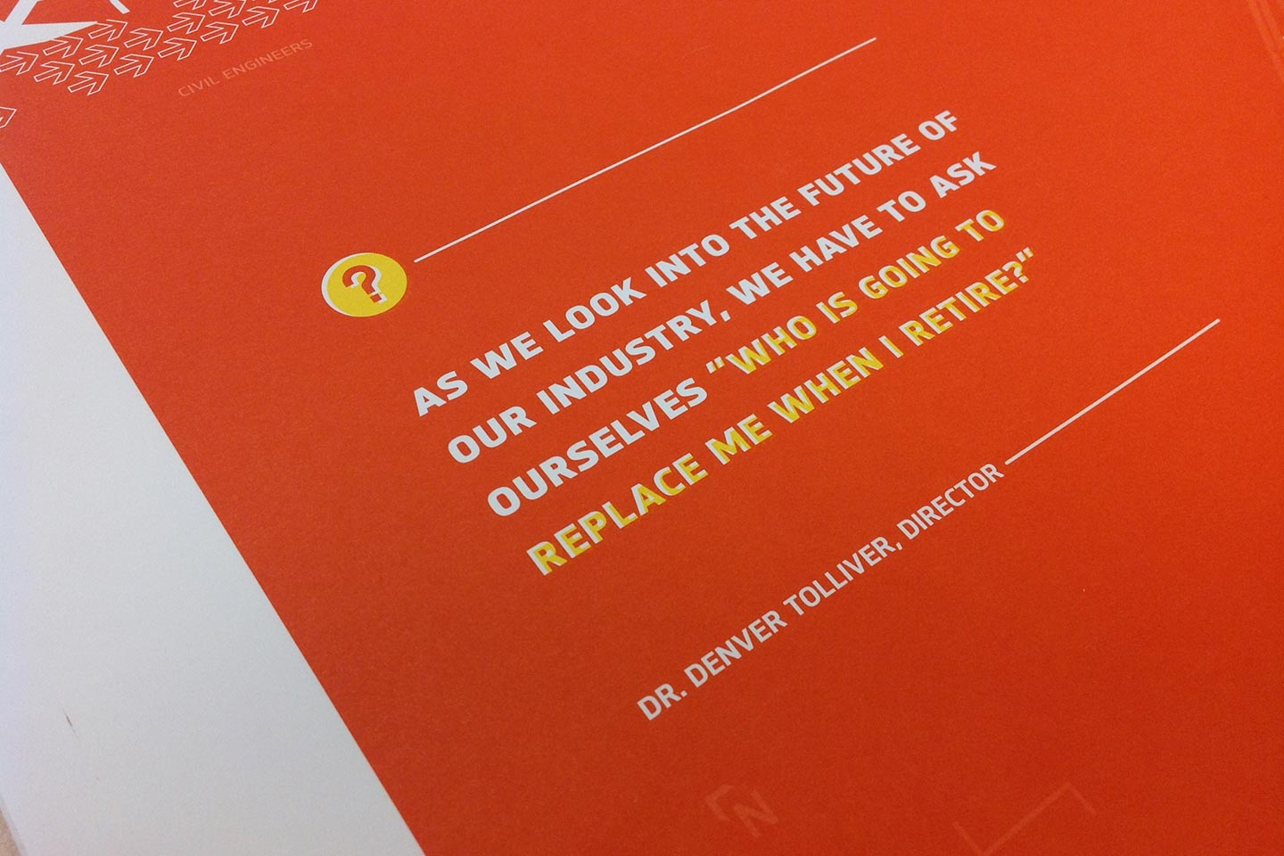 Close-up of white text on red background of transportation brochure