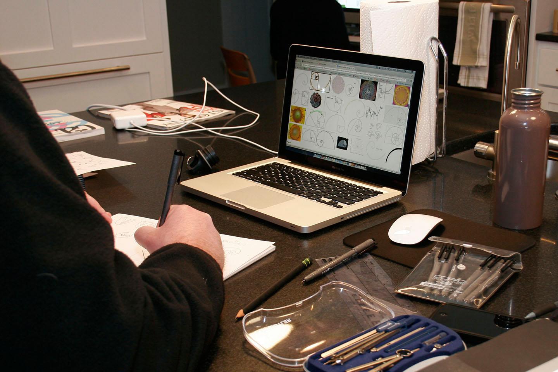 Man working on designing on a laptop