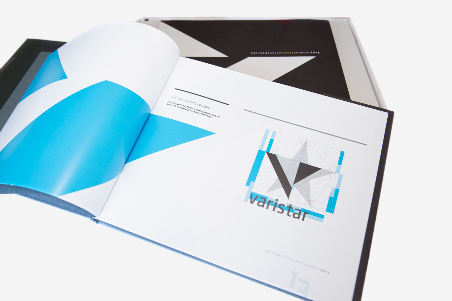 Varistar brand guideline manual open to a page showing the logo in blue and black