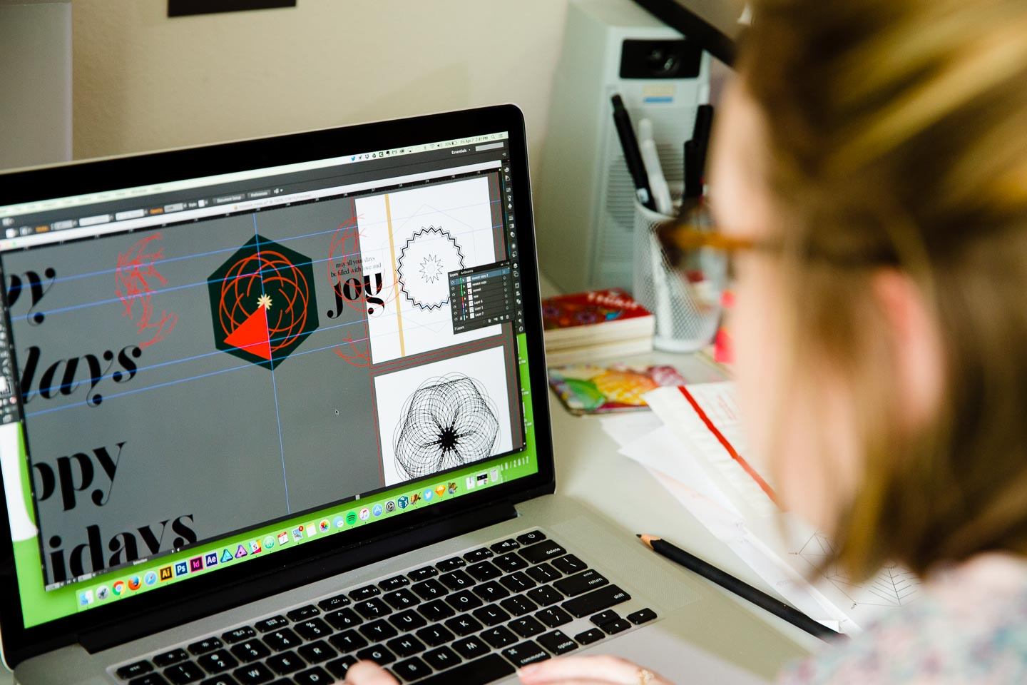 A woman designing circular patterns on a laptop