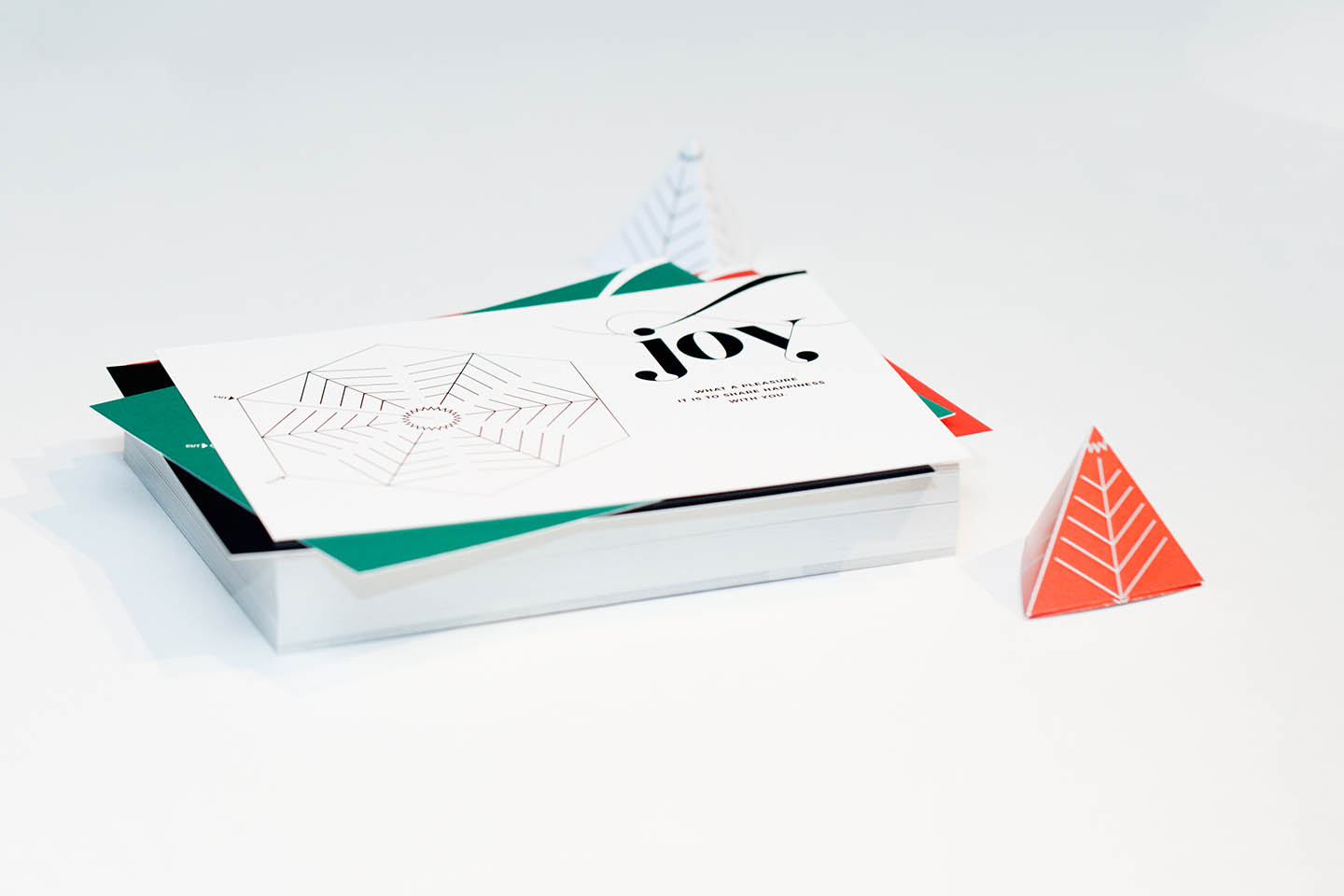 Wunderfold in its card form and folded 3D tree form in red