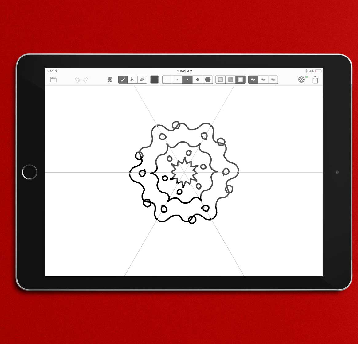 An iPad sitting on a red background displaying a circular pattern on its screen